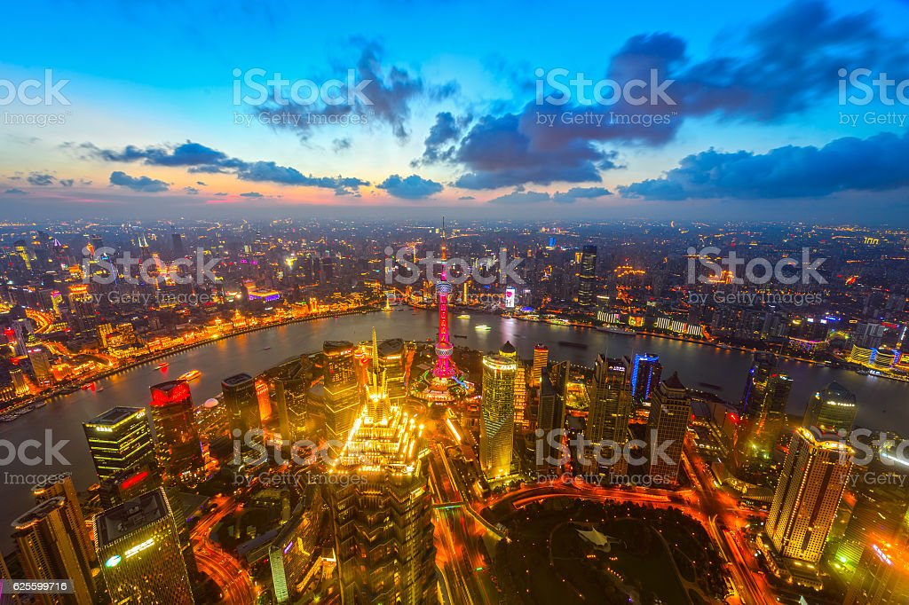 Modern cityscape and illuminated skyline at dawn stock photo