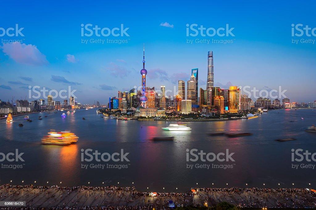 Modern cityscape and illuminated skyline at dawn stock photo