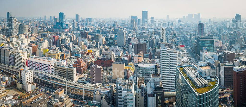 Modern cityscape panorama skyscrapers apartment buildings and highways Osaka Japan stock photo