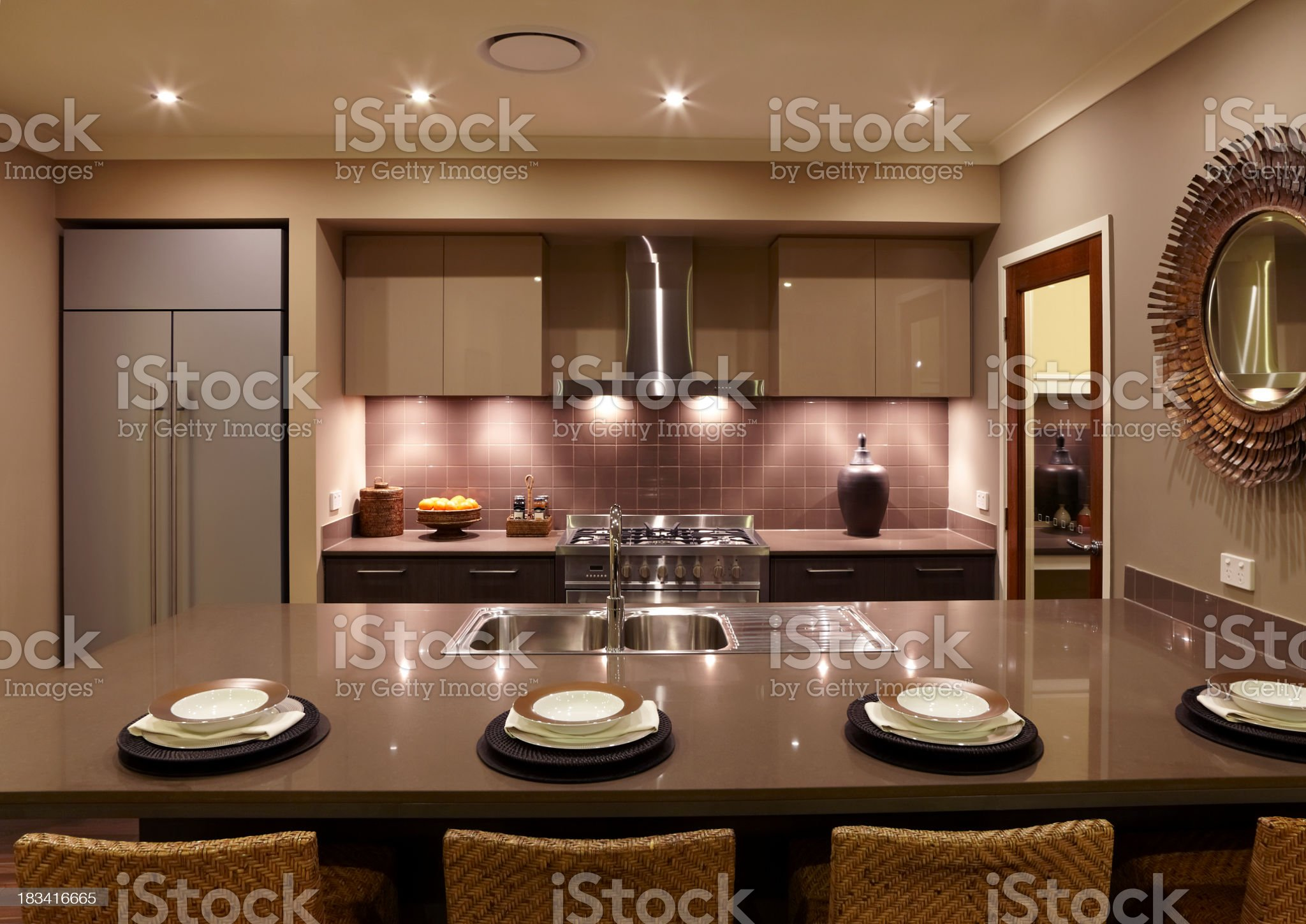 Modern coffee colored kitchen with four place settings royalty-free stock photo