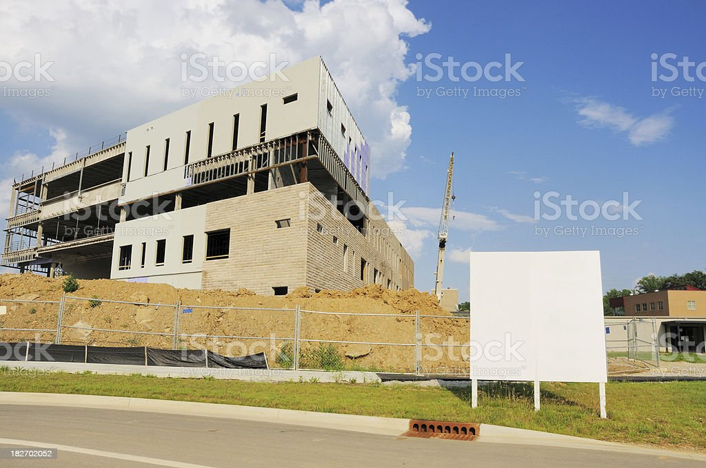 Modern College Campus Building Under Construction with Blank Sign stock photo