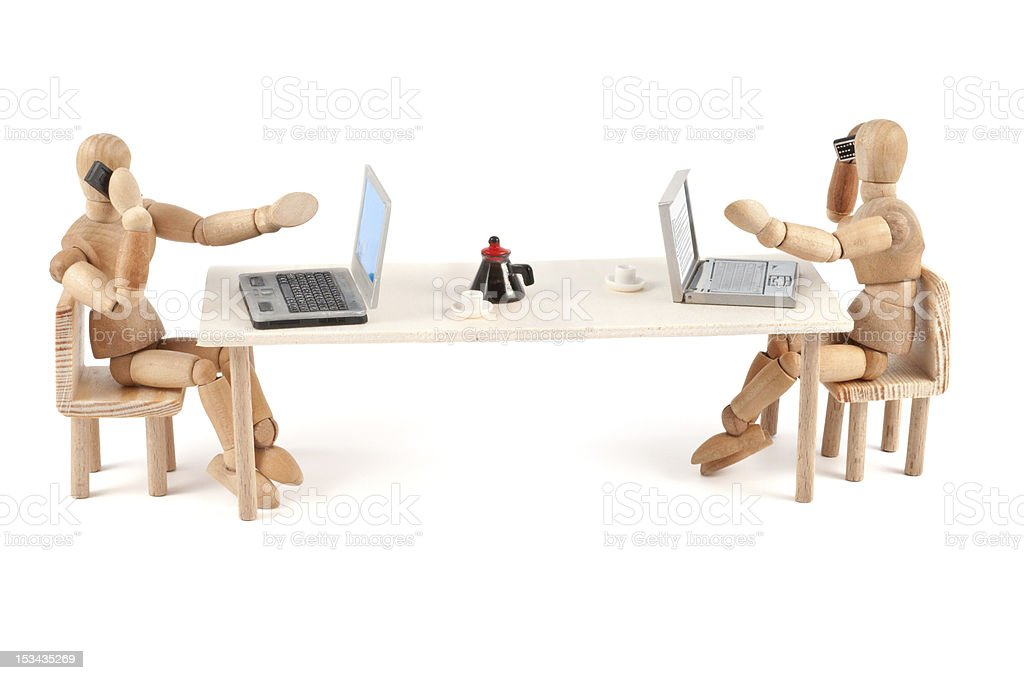 modern communication - wooden mannequin at work stock photo