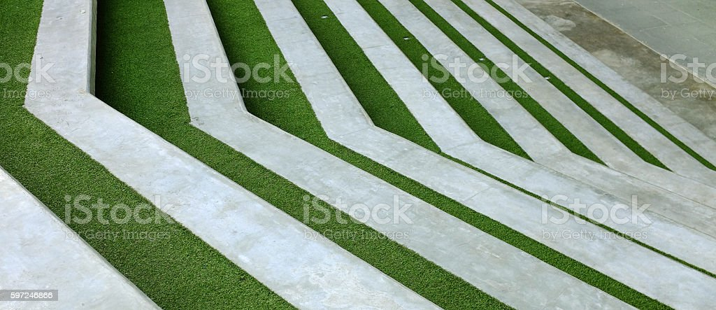 Modern concrete stair down with green grass stock photo