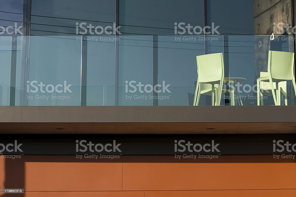 A balcony view of a modern apartment