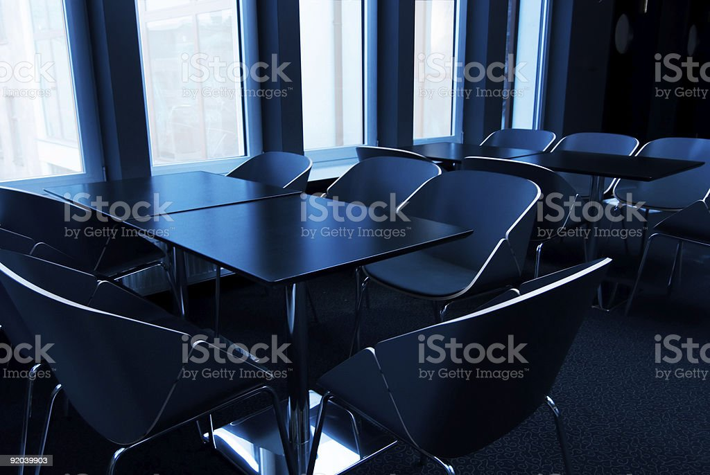 Modern conference room toned in blue royalty-free stock photo