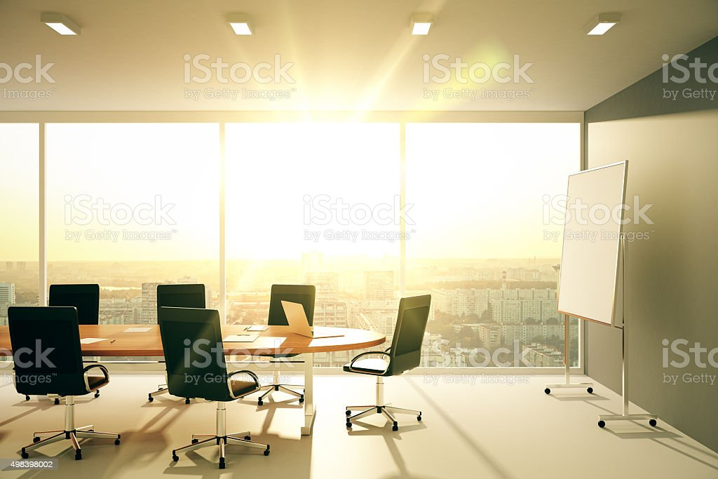 Modern conference room with furniture and city view at sunrise stock photo