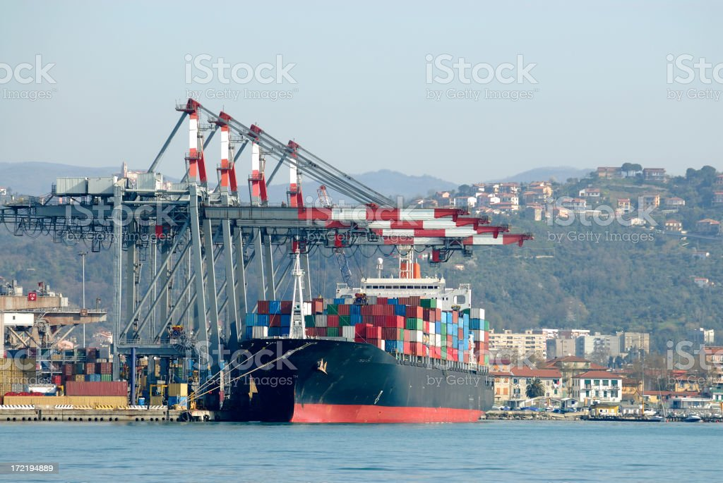 Modern container ship being loaded royalty-free stock photo