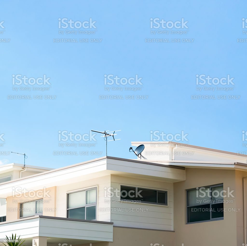 Modern contemporary house against blue square background with copy space stock photo