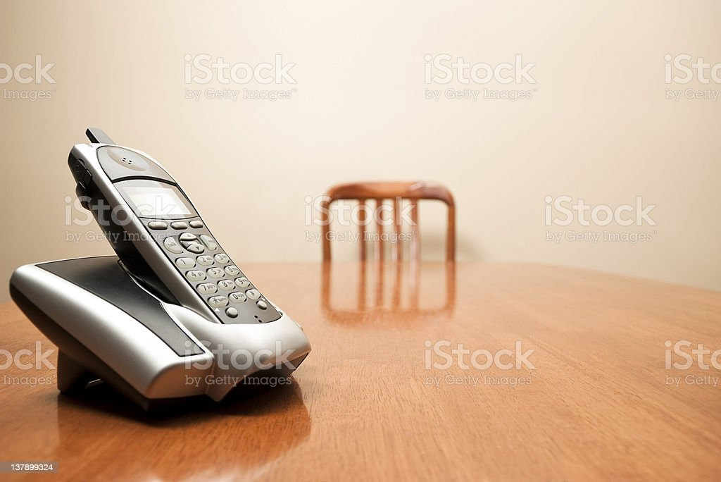 Modern cordless phone sitting on a table stock photo