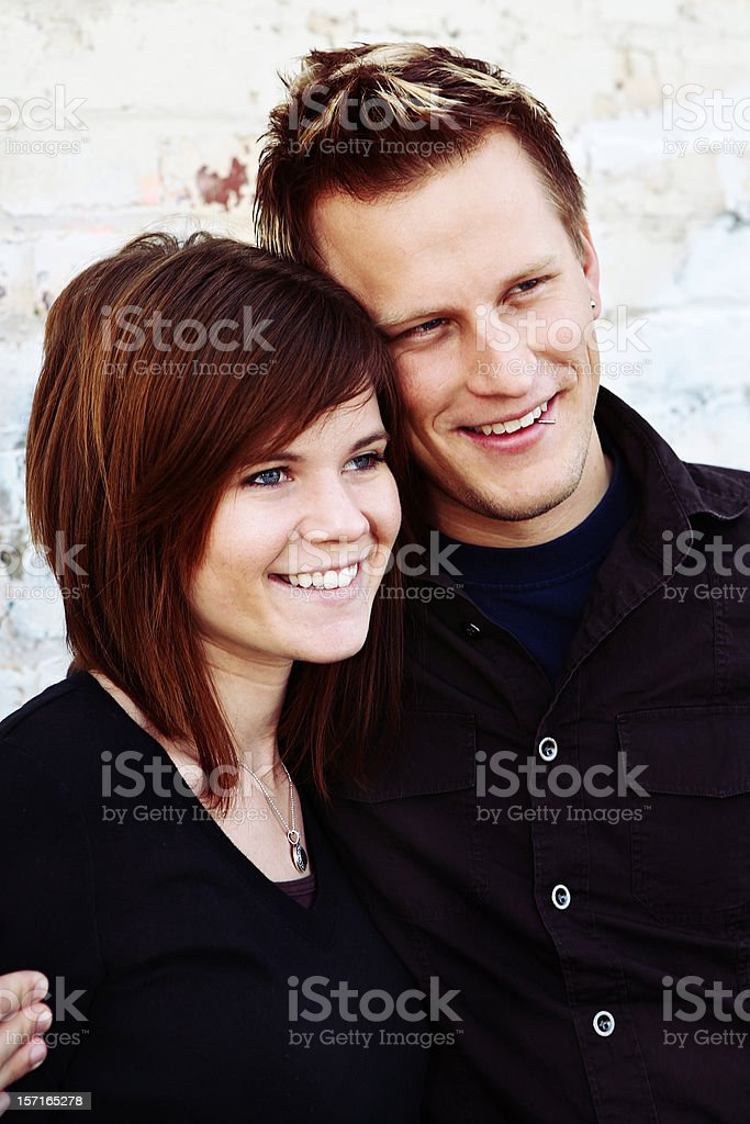 Modern Couple Looking into the Distance royalty-free stock photo