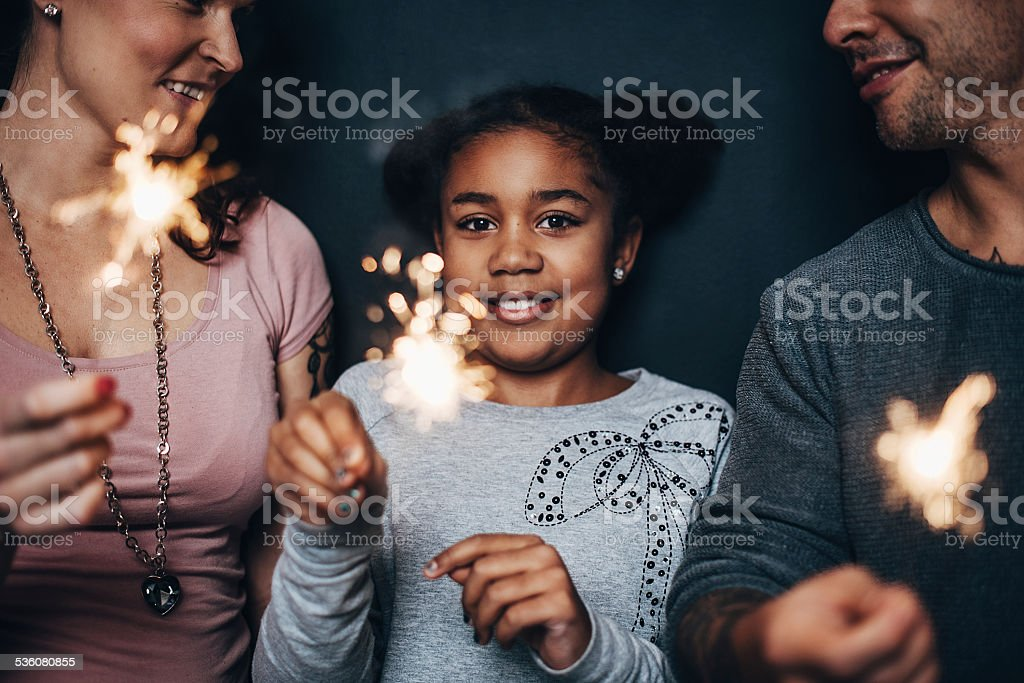 Modern cute family with sparklers stock photo