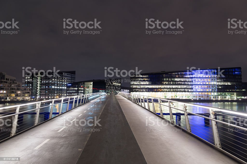 Modern cyclist and pedestrian bridge Bryggybroen in Copenhagen by night stock photo