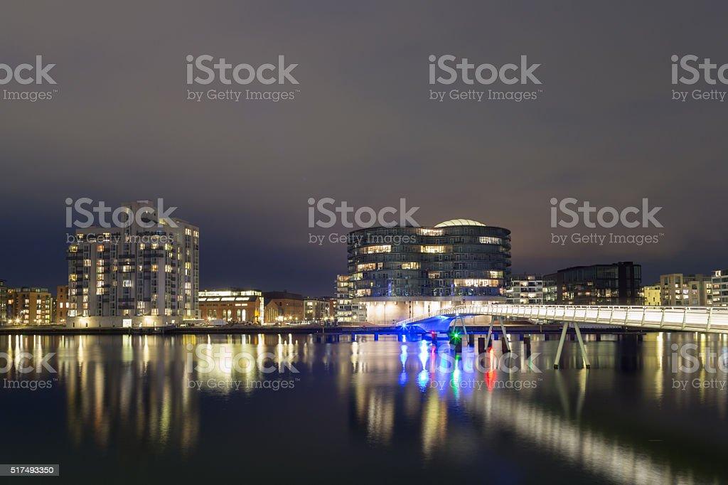 Modern cyclist bridge and Gemini Residence in Copenhagen by night stock photo