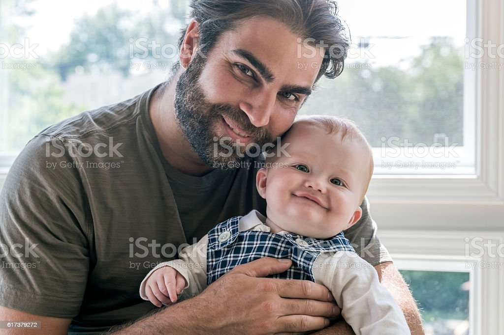 Modern Dad Posing with his Baby Boy stock photo