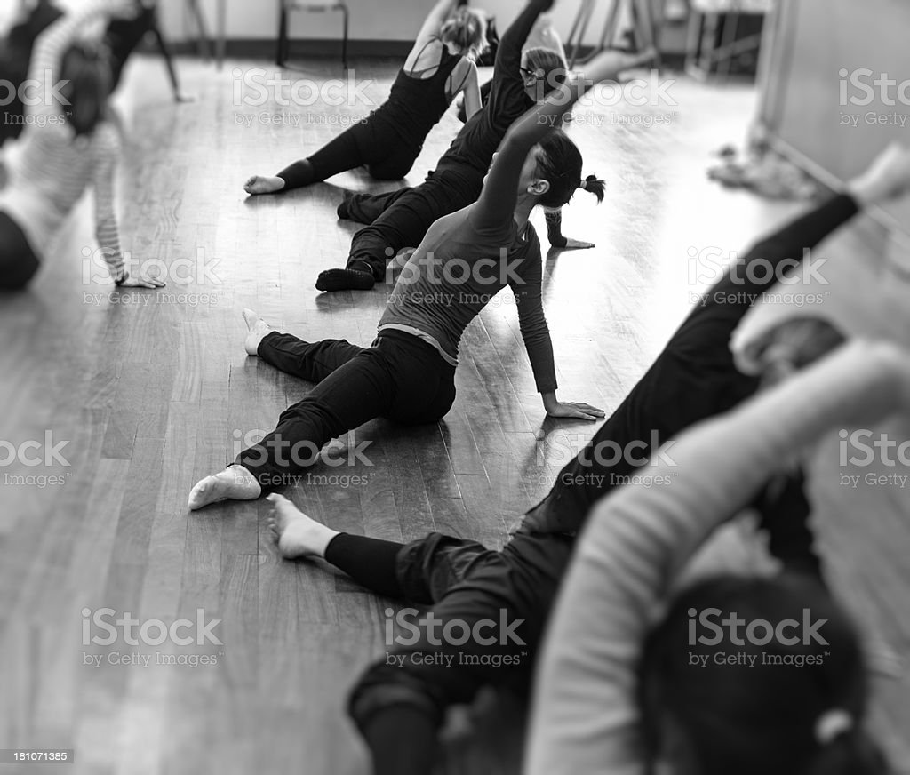Modern dance classroom with students royalty-free stock photo