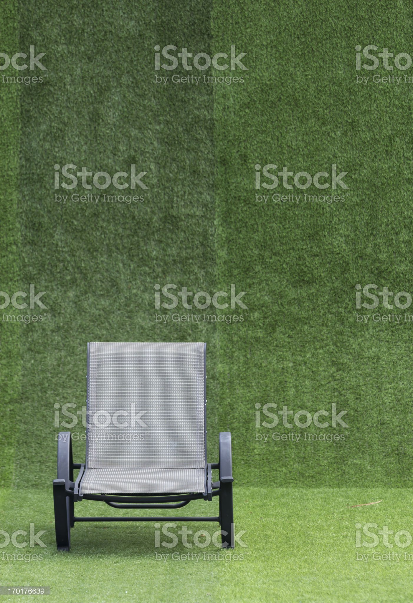Modern daybed on green field and background royalty-free stock photo
