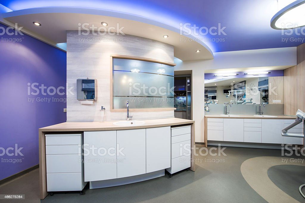 Modern dental office interior with the focus on a sink unit stock photo