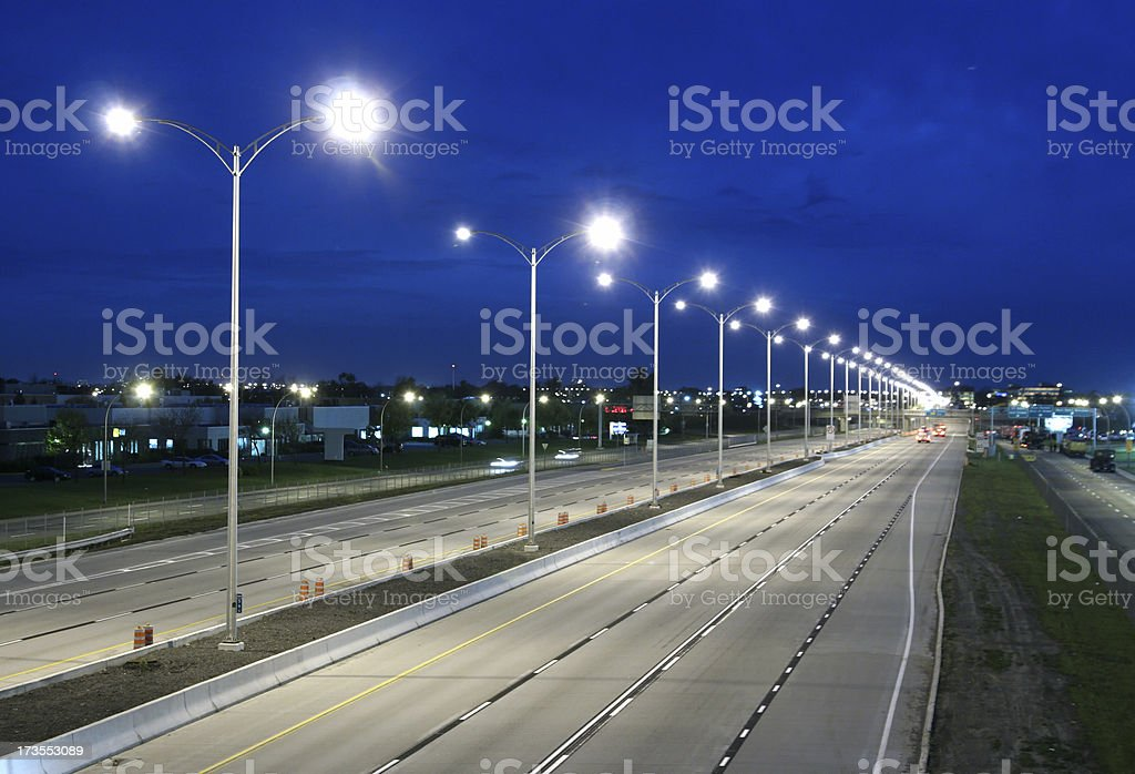 Modern deserted Highway at Night stock photo