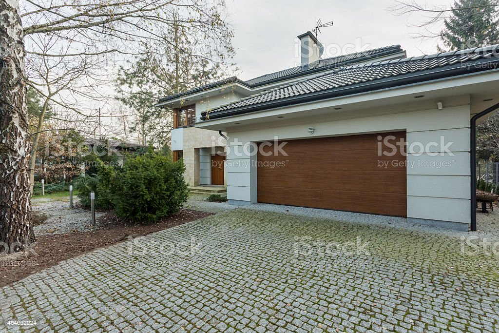 Modern detached house with garage stock photo