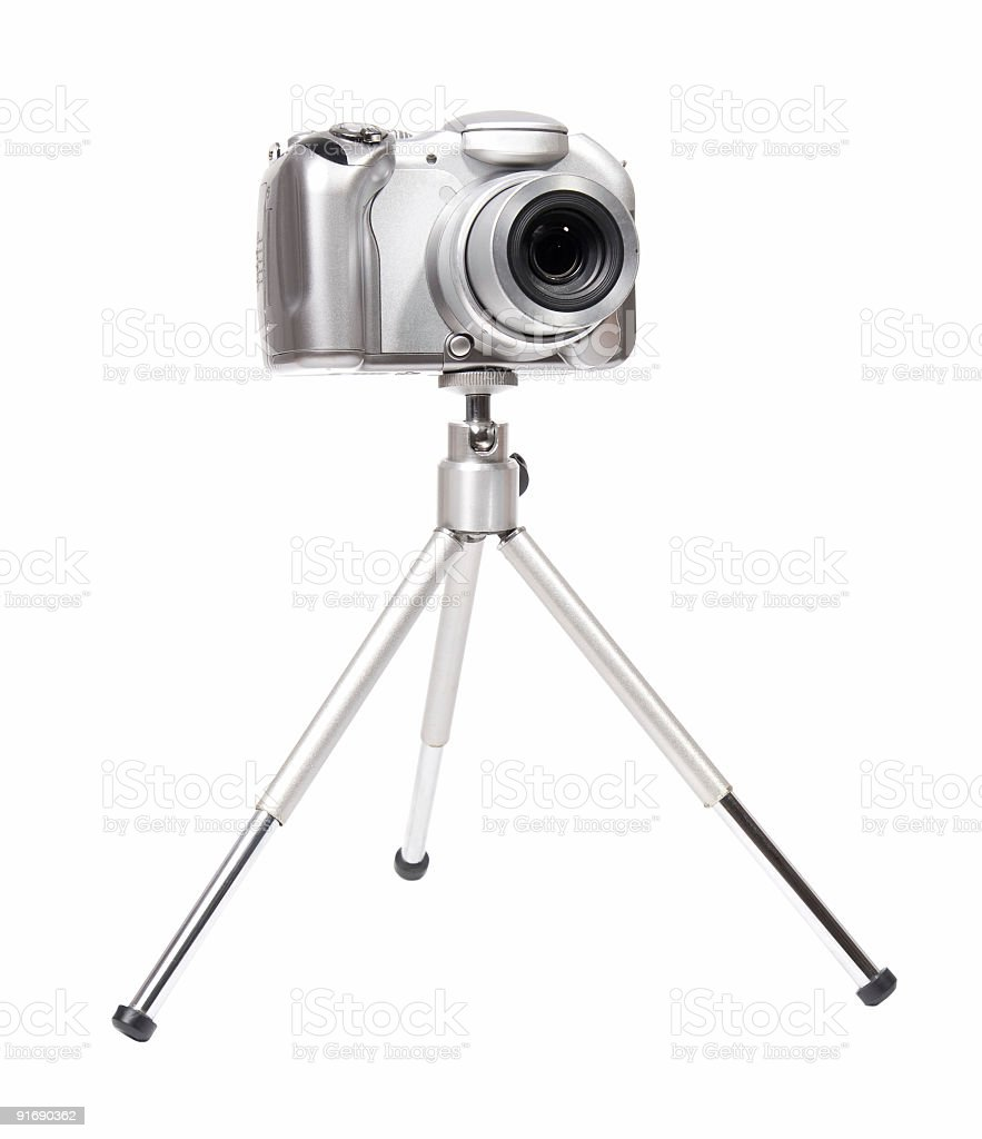 Modern digital camera with tripod royalty-free stock photo