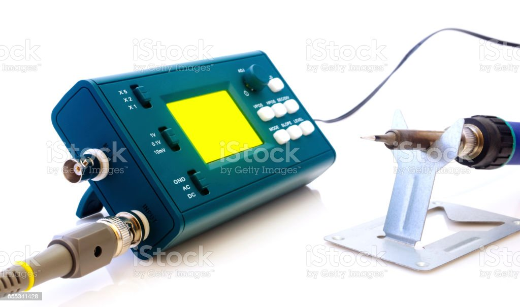 Modern digital signal oscilloscope and tools isolated on white stock photo