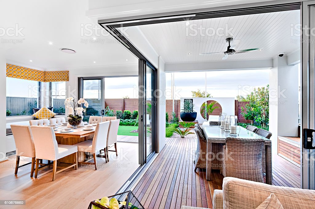 Modern dining room attached to outside patio area stock photo