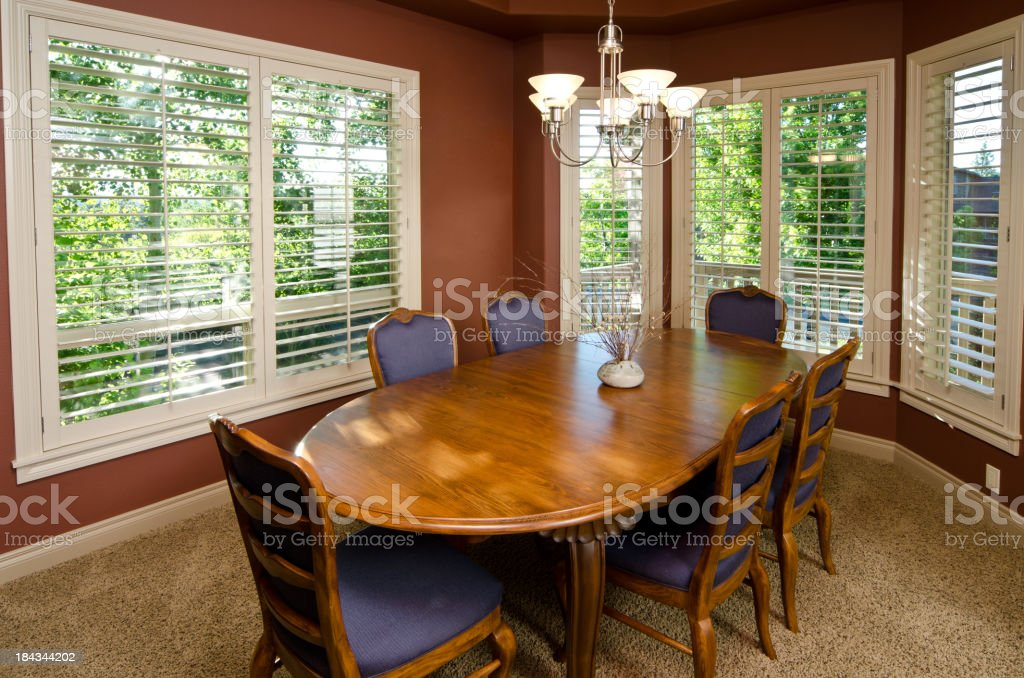 Modern dining room with carpet stock photo