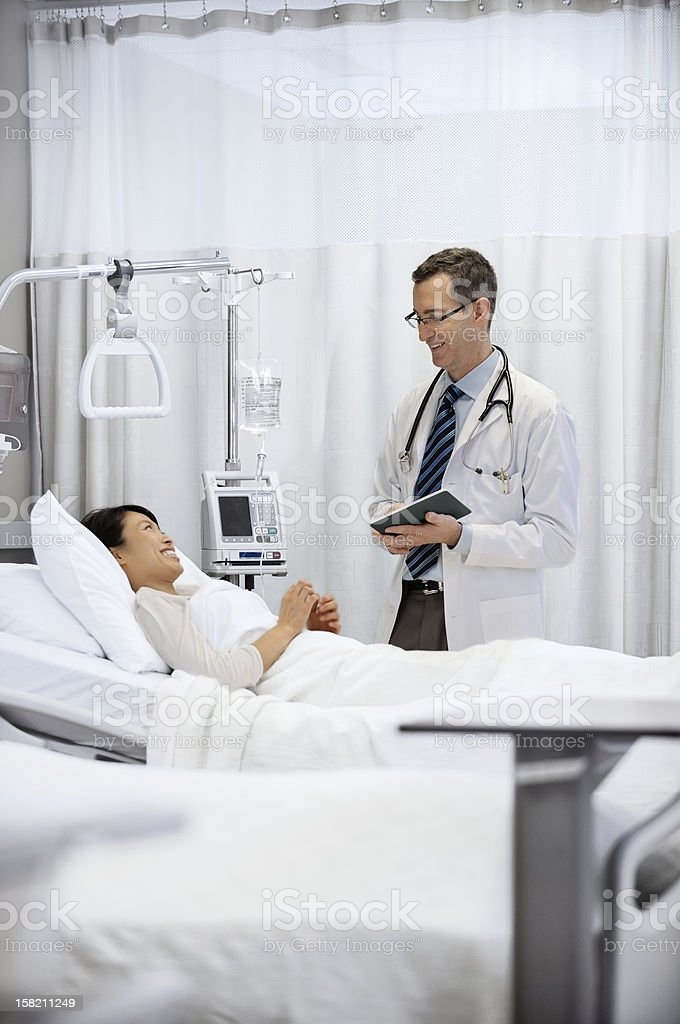 Modern doctor and patient in a hospital royalty-free stock photo