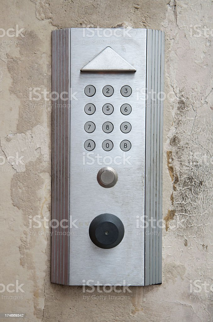 Modern Door Intercom Number Panel Old Wall royalty-free stock photo