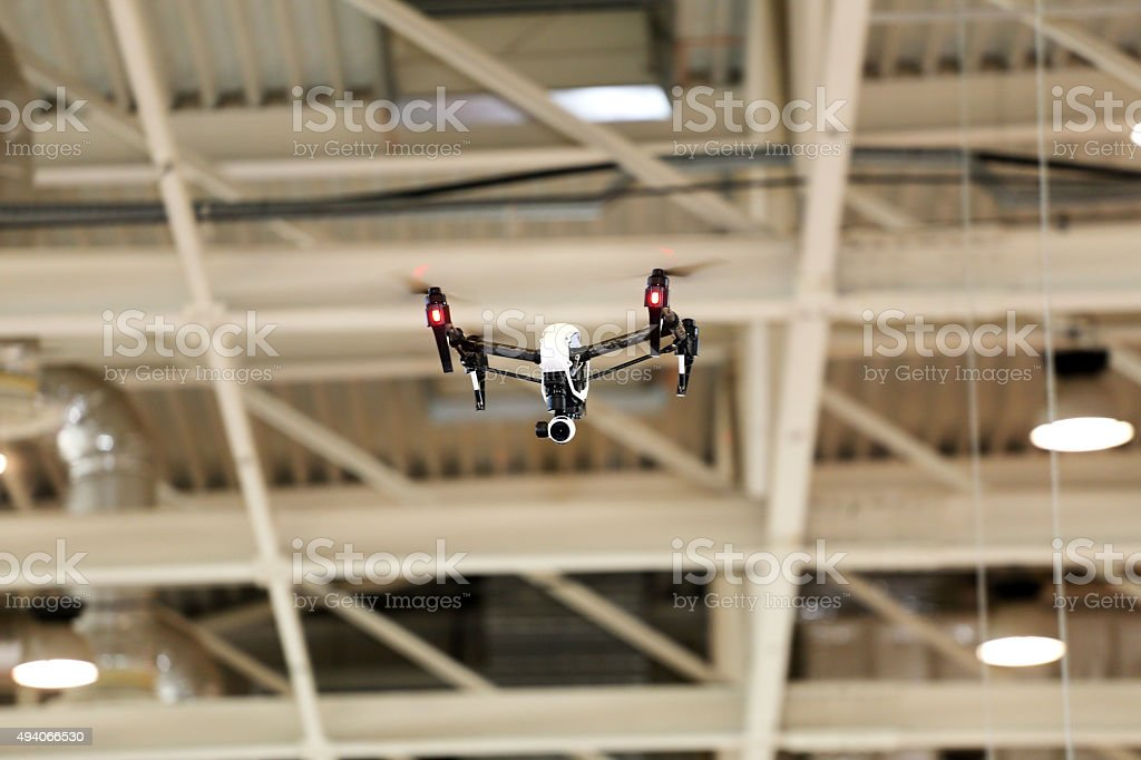 Modern  dron  flying with high resolution camera in the factory stock photo