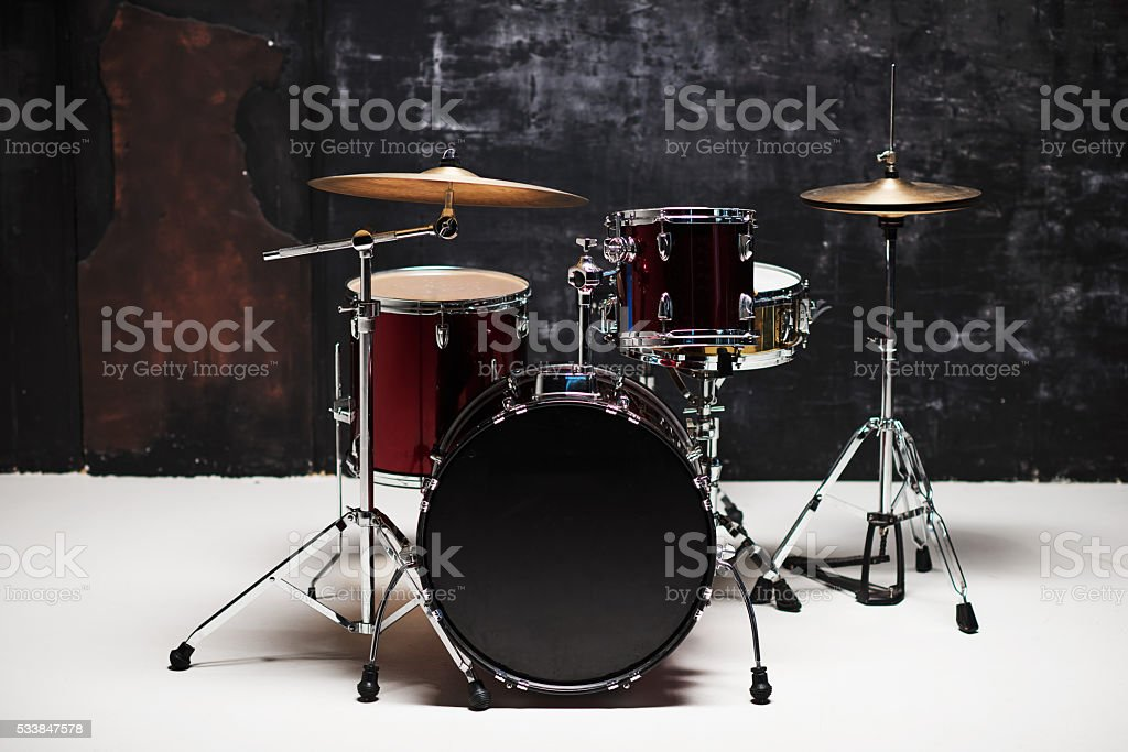 Modern drum set on black background in room stock photo