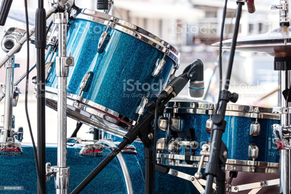 modern drum set standing in the street stage for performance. musical instruments closeup. stock photo
