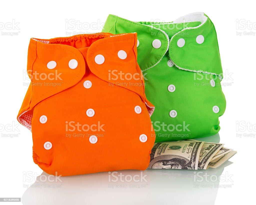 Modern eco-friendly diapers and money isolated on white. stock photo
