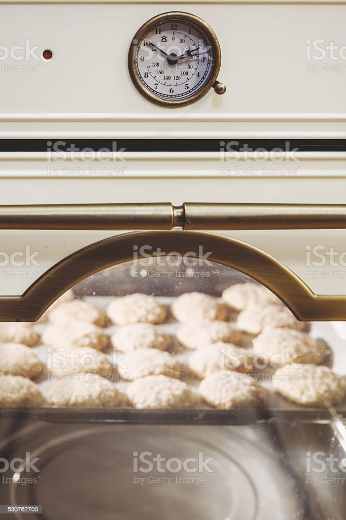 Modern electric oven. Inside baked cookies stock photo