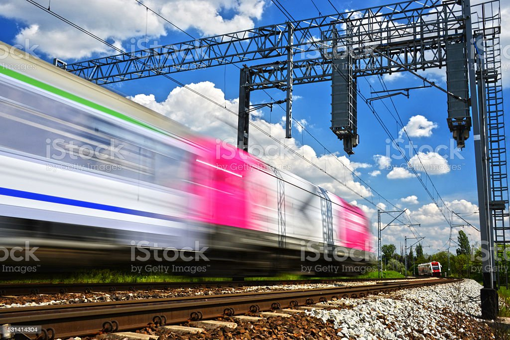 Modern electric passenger train moving on full speed stock photo