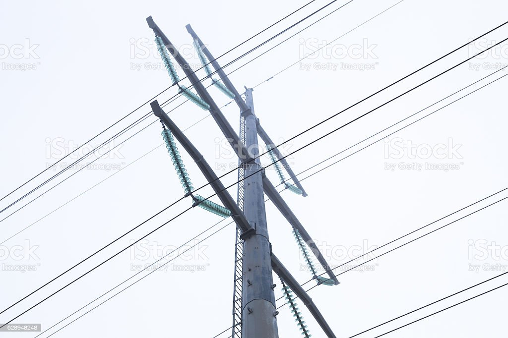 Modern electrical transmission tower and cables stock photo