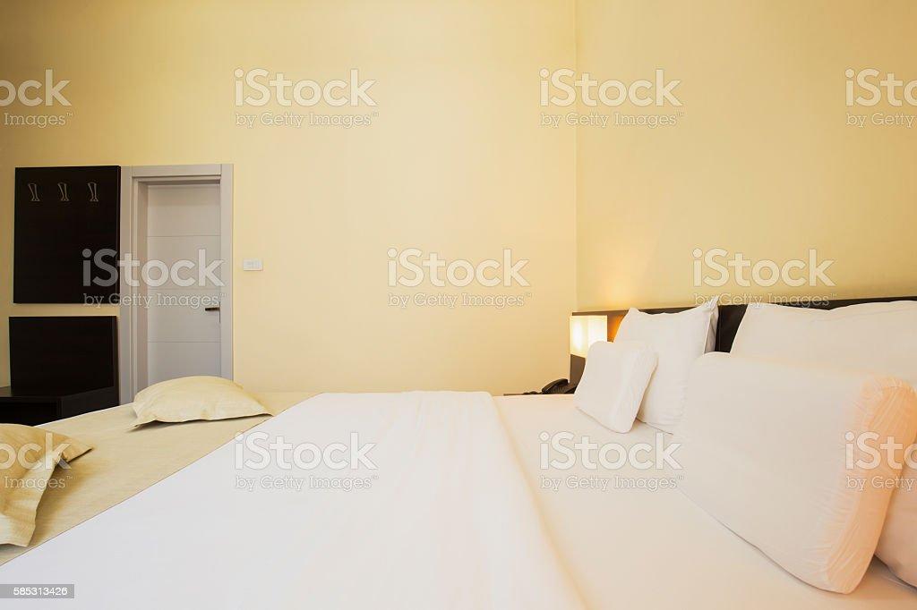 Modern elegant hotel bedroom interior stock photo