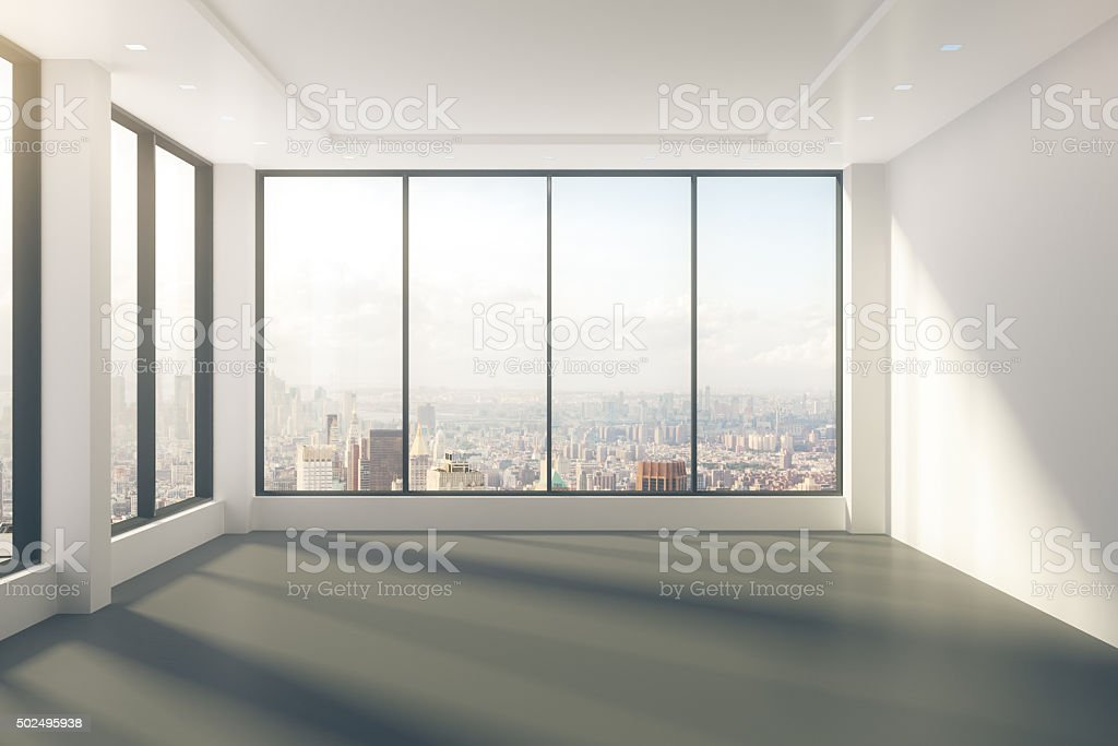 Modern empty room with windows in floor and city view stock photo