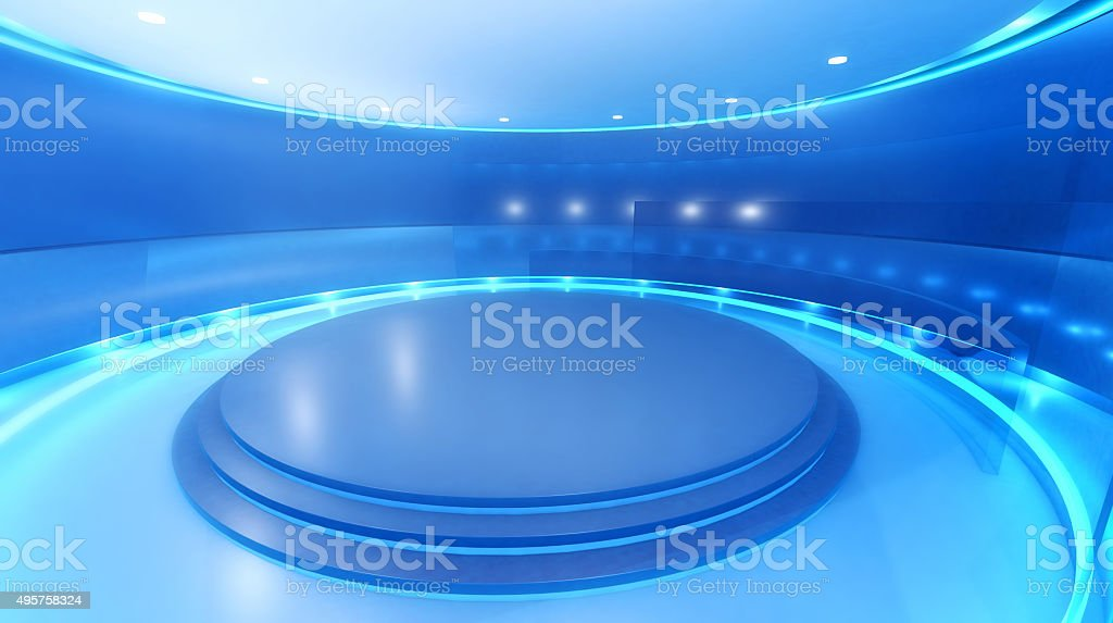 Modern empty television studio with stage and blue background stock photo