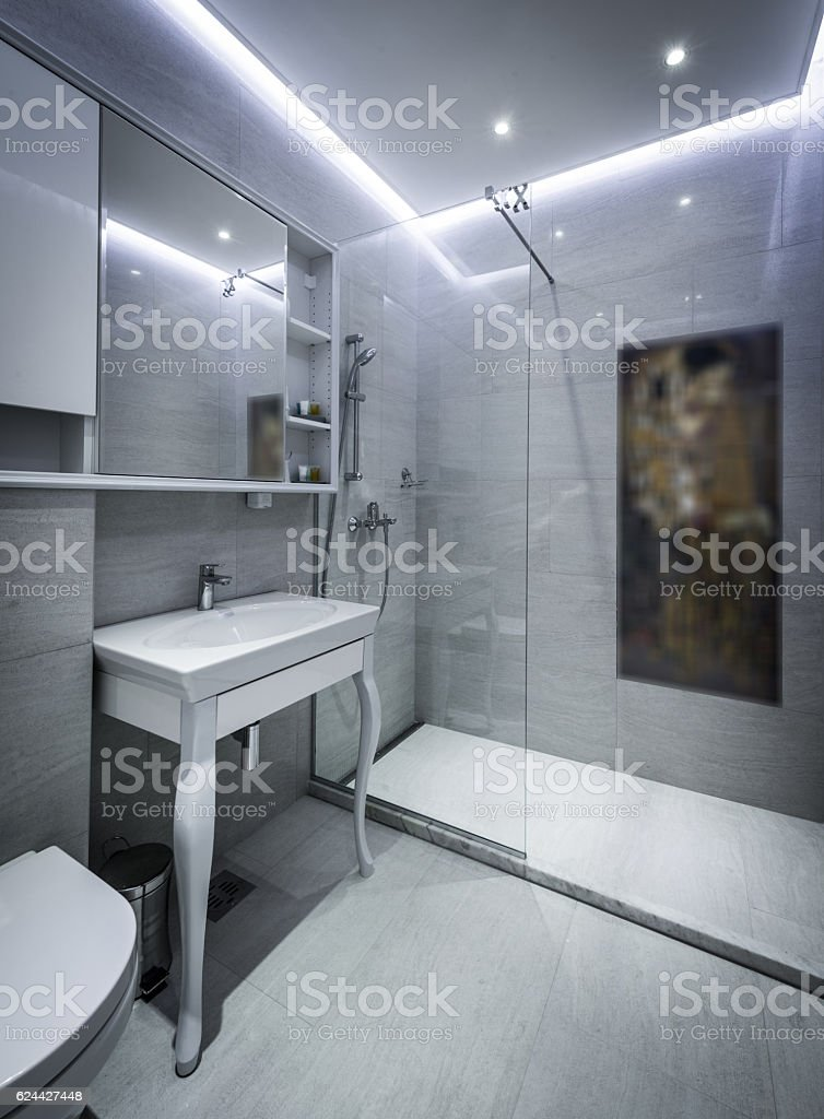 Modern en-suite bathroom with shower cabin stock photo