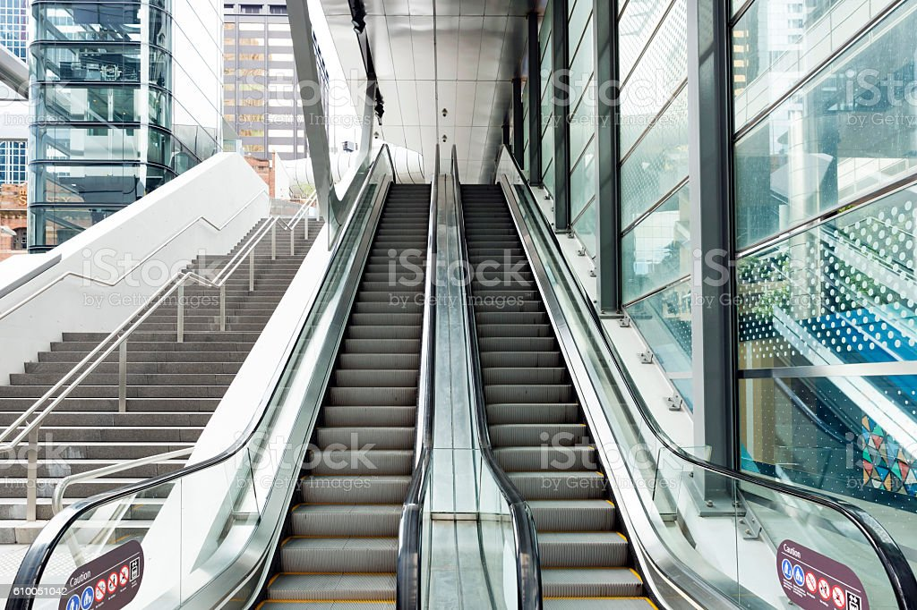 Modern escalator and staircase in glass corridor, Sydney Australia stock photo