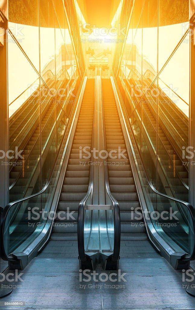 modern escalator in glass walls stock photo
