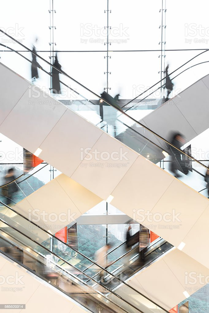 Modern Escalator with blurred people stock photo