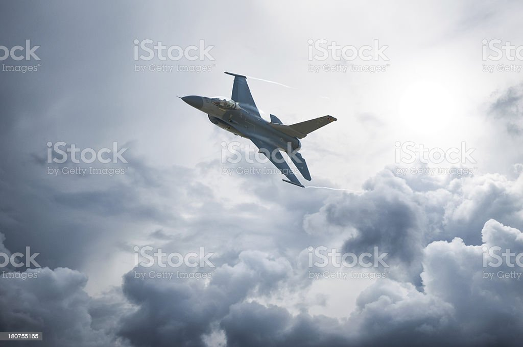 Modern F-16 Fighter Plane Above the Clouds stock photo