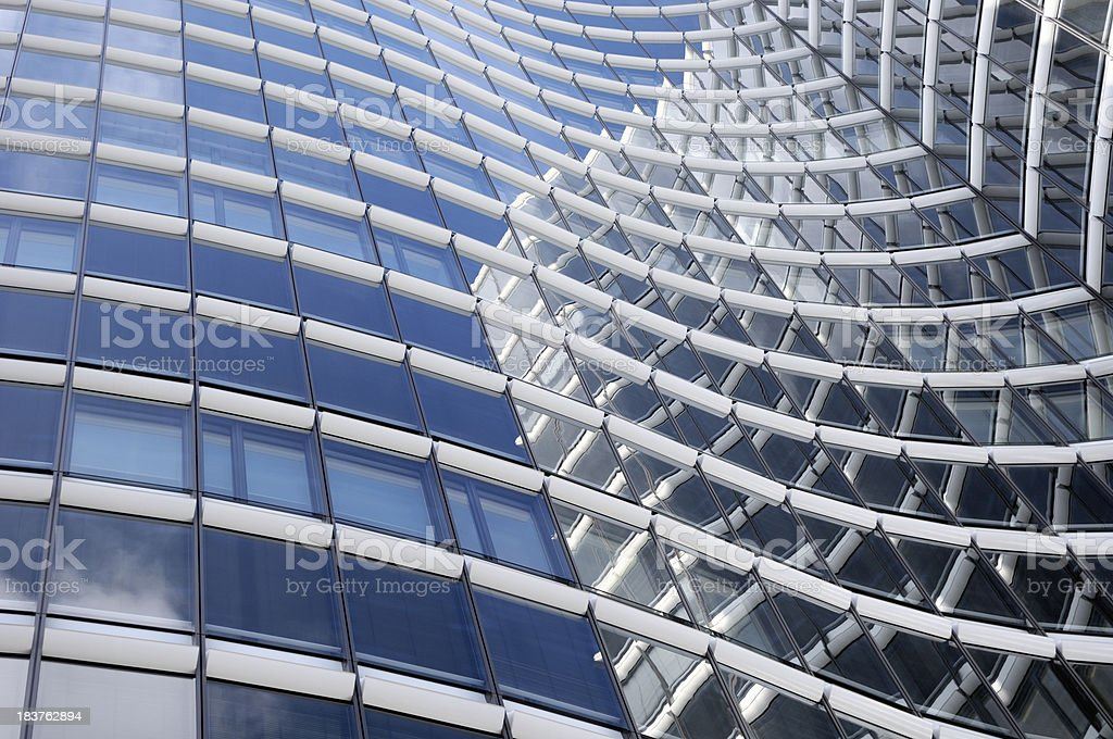Modern facade with reflections of a skyscraper royalty-free stock photo