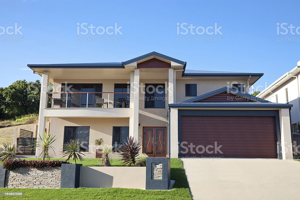 Modern Family Home Front with blue sky royalty-free stock photo