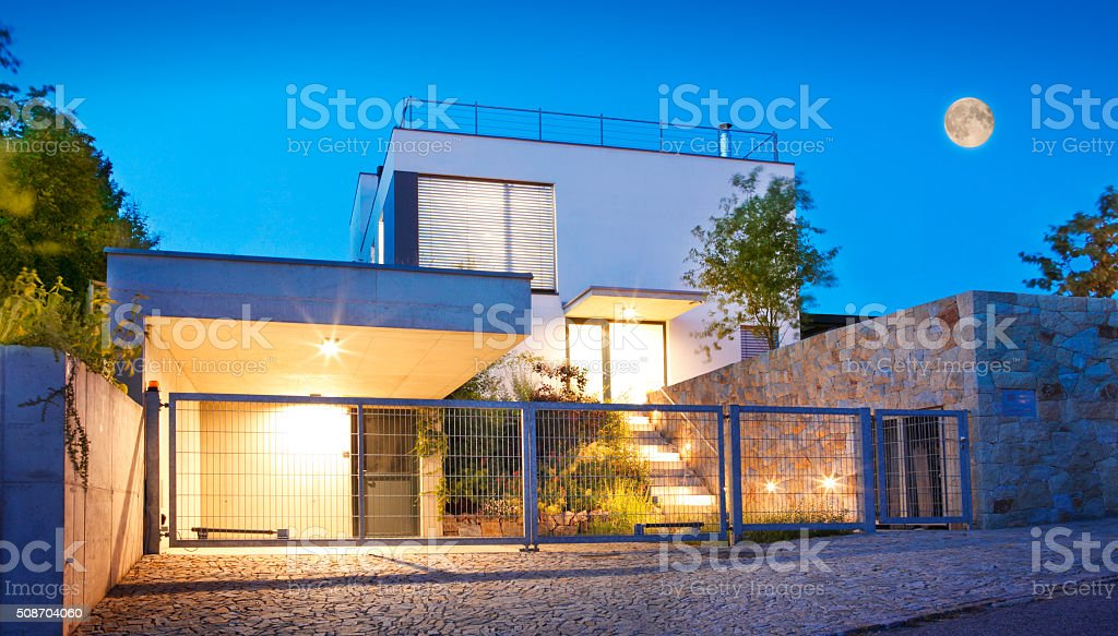 Modern family house exterior by twilight stock photo