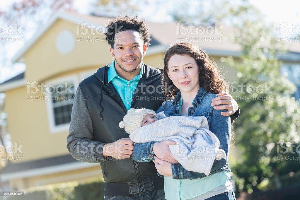 Modern family - interracial couple with baby boy stock photo