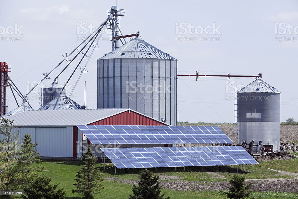 Modern Farm with Grain Elevator and Solar Panels royalty-free stock photo