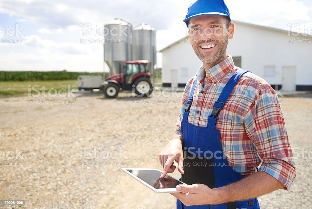 Modern farmer and his business stock photo